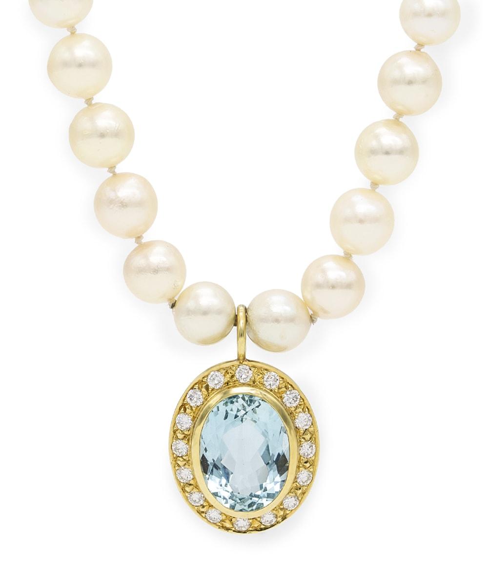 Perlenkette mit Brillante und einem Blautopas 585er Gold